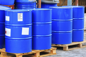 Big blue barrels on wooden pallets