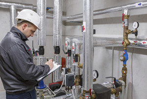 Technician-inspecting-heating-system-000059146768_Full